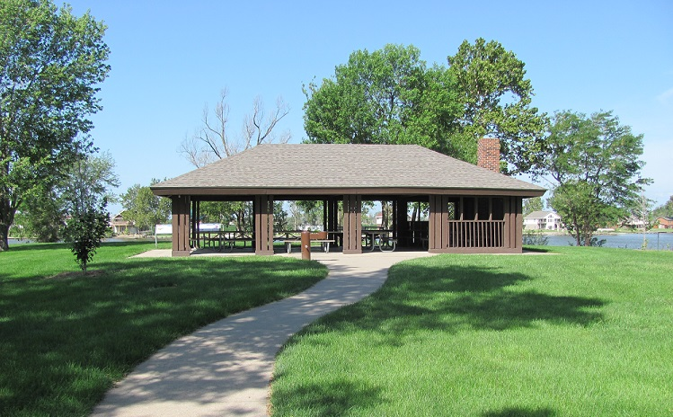 picnic shelter with lake in the background