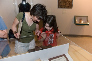 Mother and daughter looking at exhibits in the visitor center