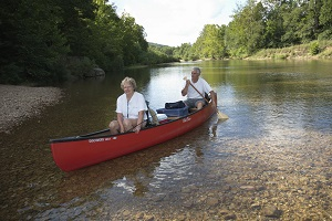 two people floating in a canoe