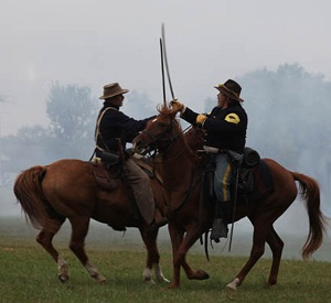 Battle re-enactors on horses fighting with swords
