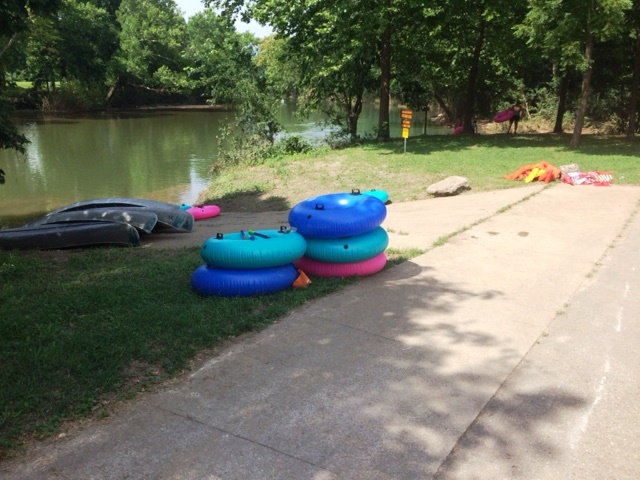 inner tubes and canoes around the boat launch