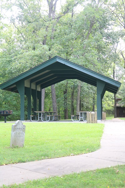 Picnic shelter under lofty trees