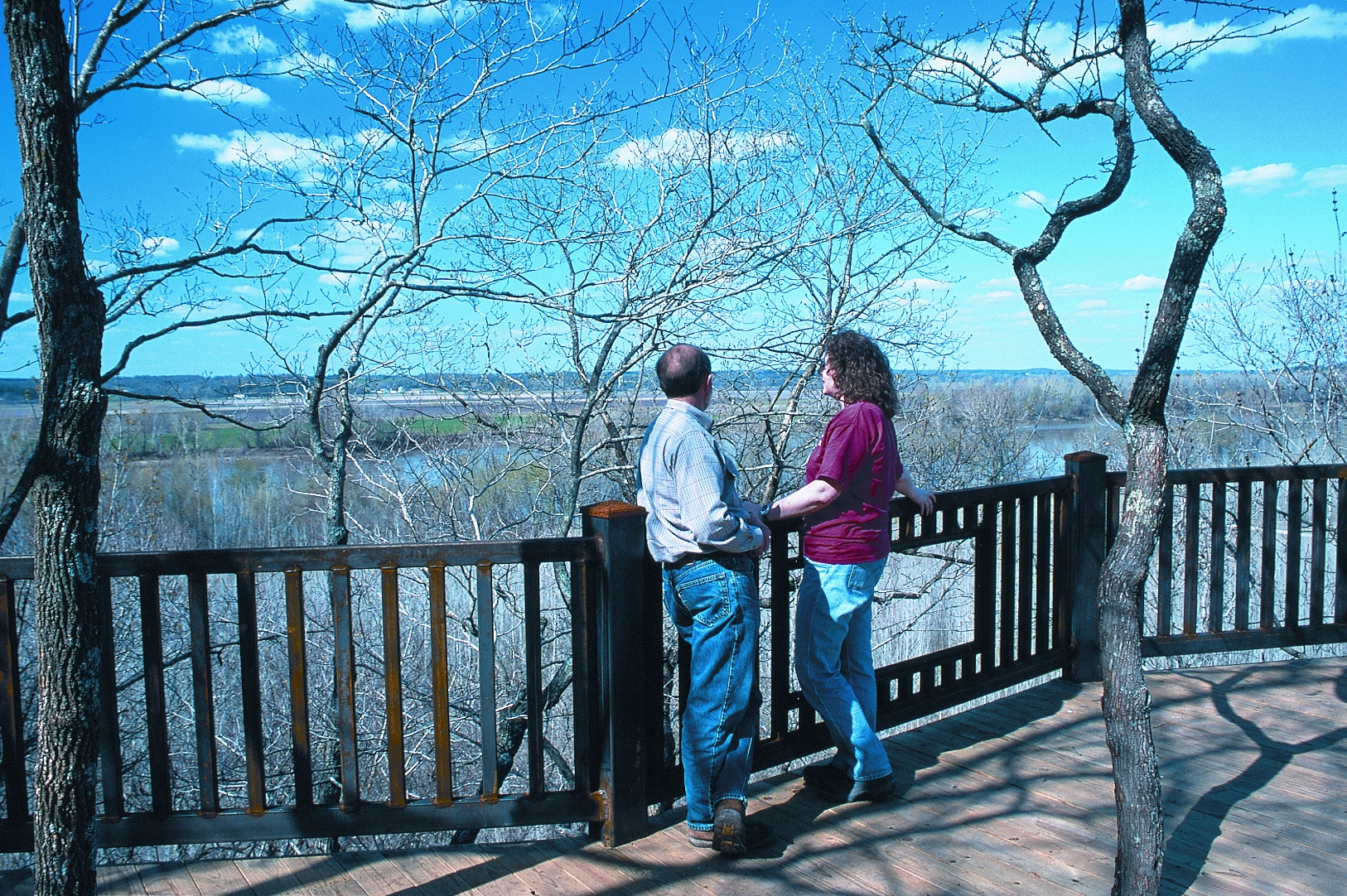 a couple looking at the view of the river from the overlook