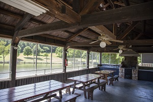 picnic tables and fire place inside the boat house shelter