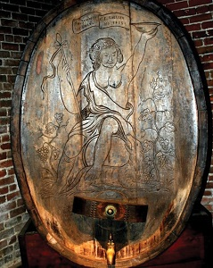 old wood wine cask with carving on front