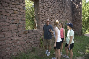 Family of four looking at the rock engine house ruins