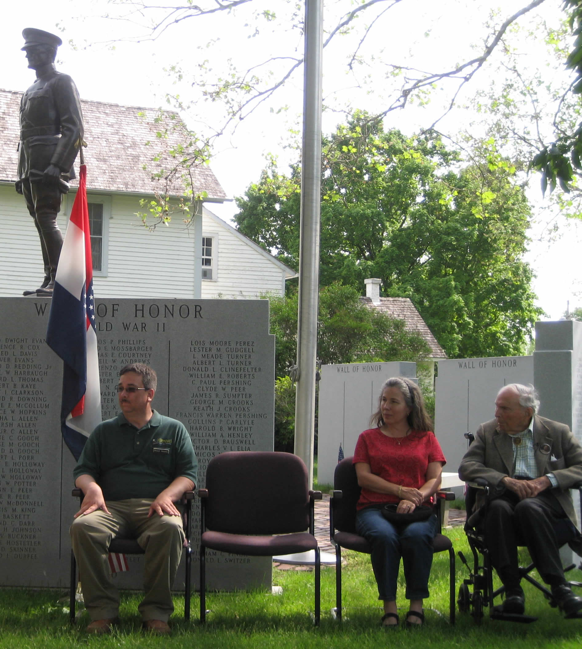 Frank Buckles and two other people sit during a ceremony at the historic site