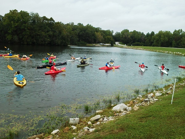 numerous people in kayaks on the lake