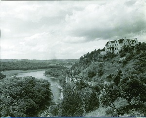 historic photo of castle on top of bluff overlooking the lake