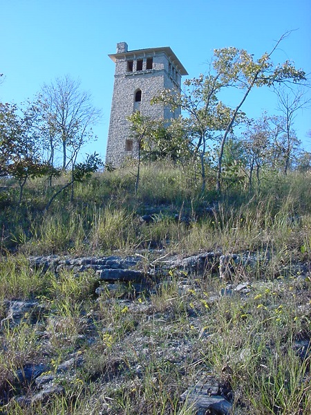 rock water tower ruins on top of a hill
