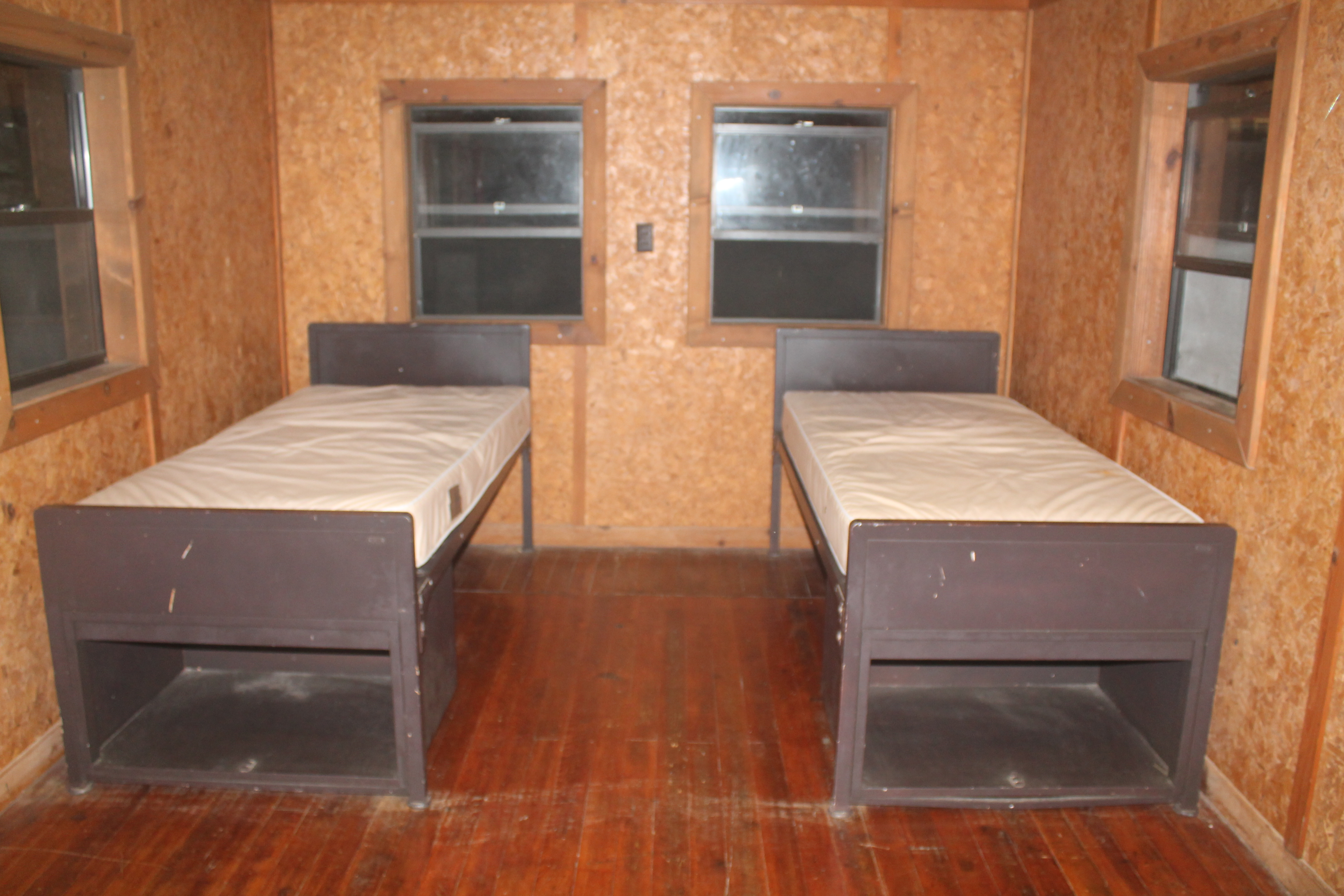 two twin beds inside one of the cabins
