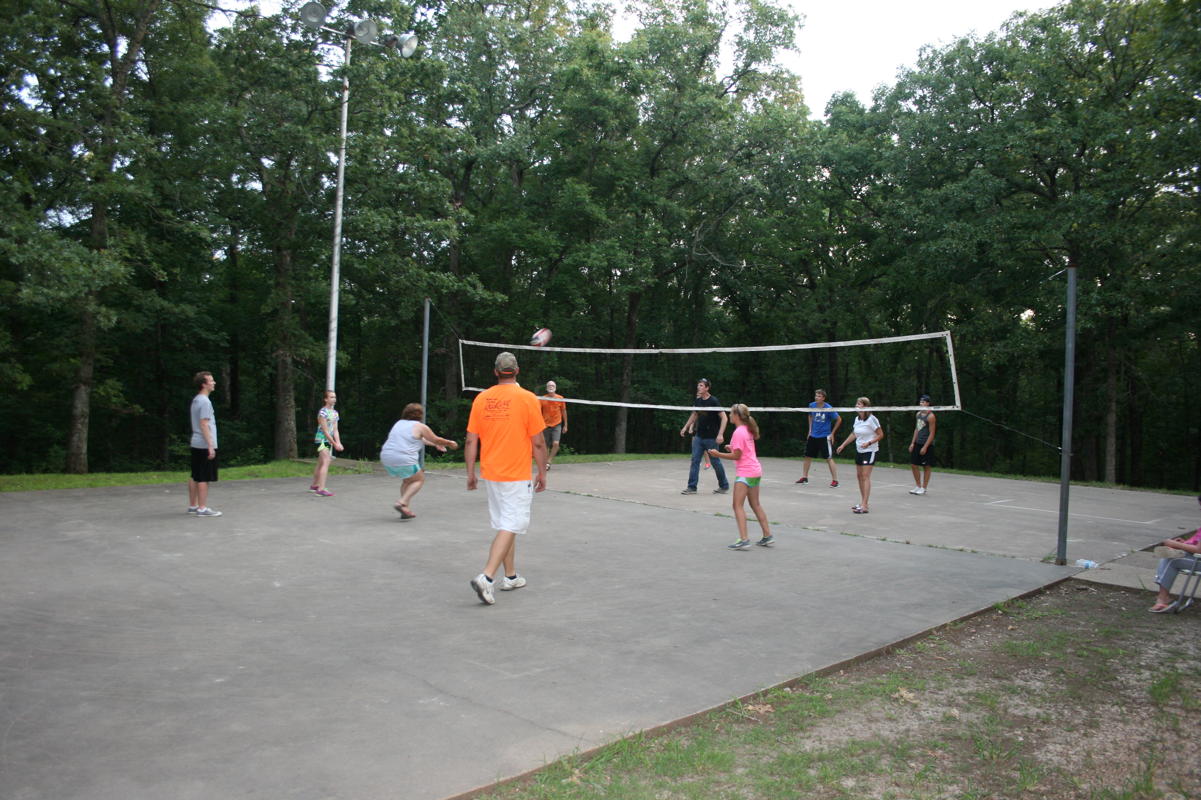 people playing volleyball on the play court