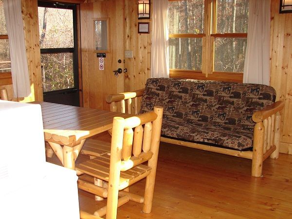 table and  futon in cabin