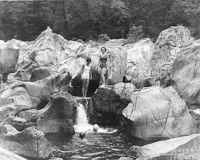 historic photo of two women swimming at Johnson's Shut-Ins State Park