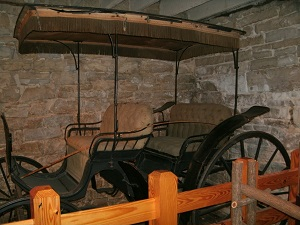 old carriage on display inside the Lohman Building