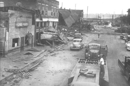 buildings falling and other damage on Kansas Avenue and Berger