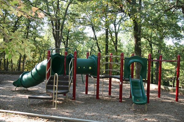 playground with slides in a shaded area