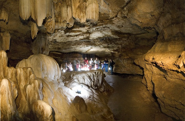 A group on tour inside Ozark Caverns