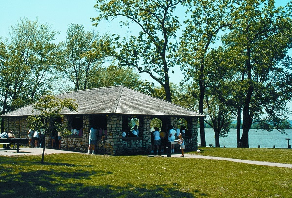 A stone picnic shelter at Lewis and Clark State Park next to the lake