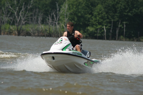 a man riding a personal watercraft on the lake