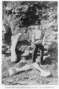 man standing with bones found at the site