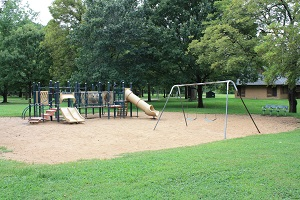 playground equipment with multiple slides and a swing set