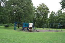 playground equipment with slides and a swing set