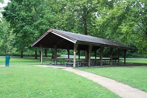 picnic shelter and sidewalk leading to it