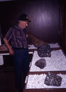 a man looking at some of  the minerals on display