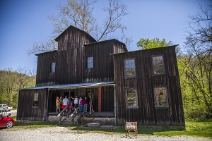 people on the porch of the mill