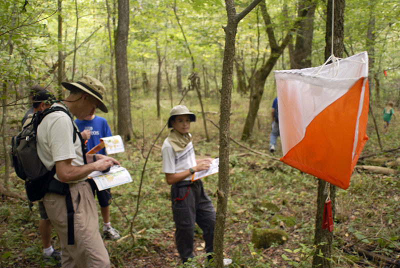 Group of people recording a point on an orienteering course