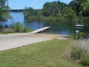 paved boat ramp and wooden dock