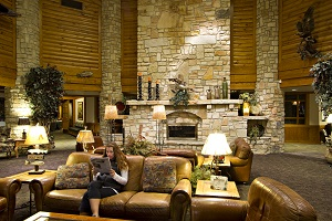 Large rock fireplace and rustic decor of interior of the lodge
