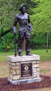 bronze statue of Civilian Conservation Corps member