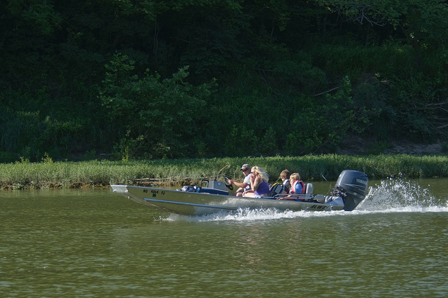 several people in a boat on the river