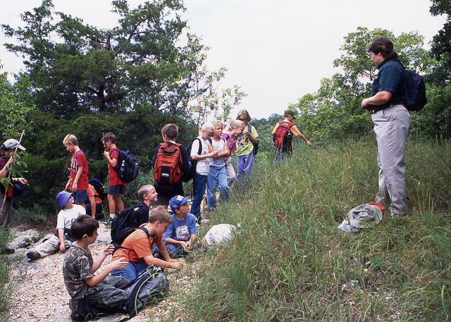 a group of kids on a guided hike with the naturalist