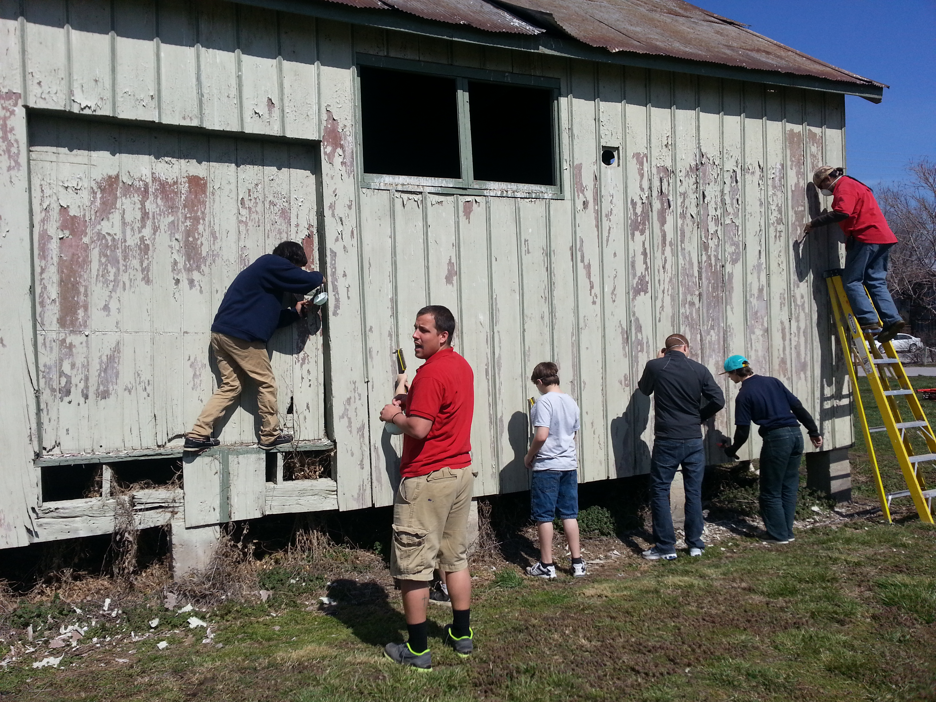 a group painting a building