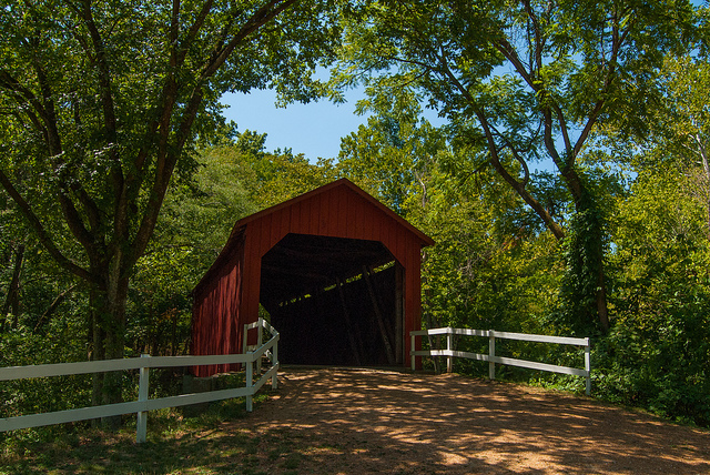 the entrance to the red covered bridge