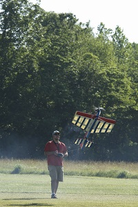 a man controlling a radio-controlled air plane
