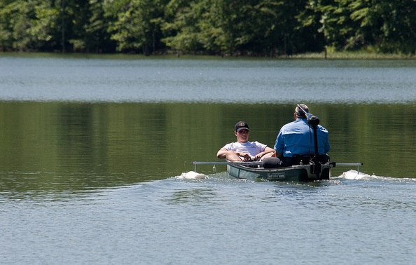 two people in a boat on the lake