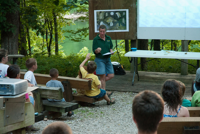 a naturalist presents a program in the amphitheater