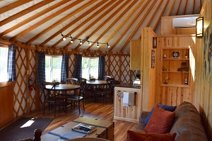 tables and kitchenette area of the yurt