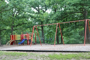playground equipment with a slide and a swing set