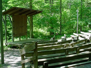 wooden benches and the stage at the amphitheater
