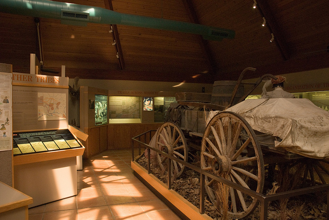 an old wagon on display in the visitor center