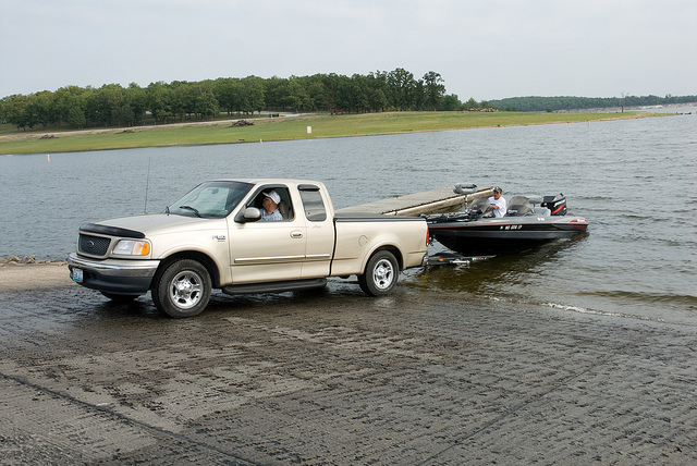 a truck unloading a boat using the concrete boat ramp