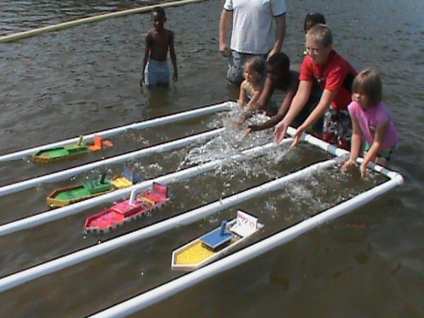 kids racing toy, non-motorized boats in the lake