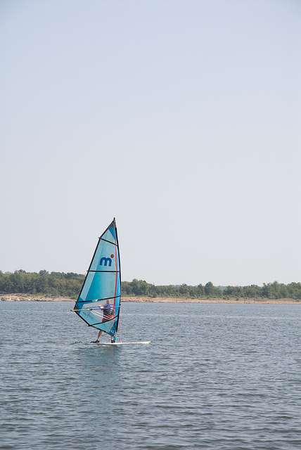someone windsurfing on the lake