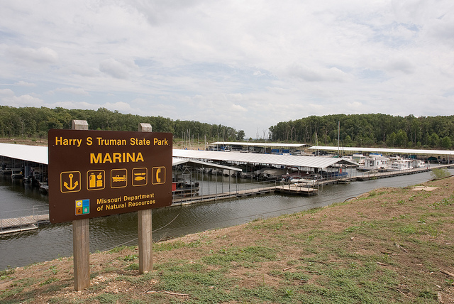 marina sign with the many boat slips in the background