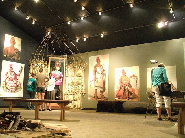 people looking at displays relating to Native Americans inside the visitor center